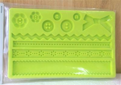 Khuôn chocolate/Fondant silicone hình ruy băng và nút áo
